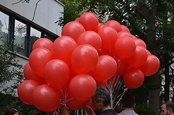 June 22, 2017 - Ankara, Turkey - A woman holds red balloons to release them into the sky in support of sacked academic Nuriye Gulmen and primary school teacher Semih Ozakca in Ankara, Turkey on June 22, 2017. The educators were arrested by a court decision on the 76th day of their hunger strike a month ago on May 23. (Credit Image: © Altan Gocher/NurPhoto via ZUMA Press)