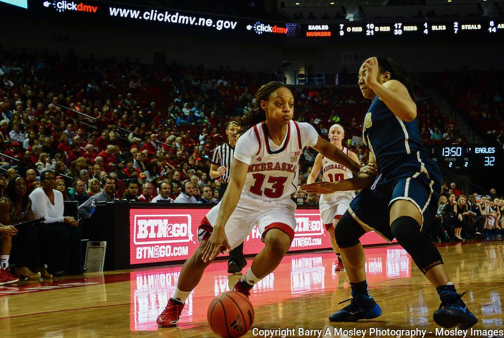 University of Nebraska's Brandi Jeffery drives to basket against Oral Roberts University defender.