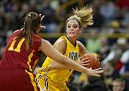 December 09 2010: Iowa guard/forward Hannah Draxten (31) is defended by Iowa St. guard Kelsey Bolte (11) during the first half of their NCAA basketball game at Carver-Hawkeye Arena in Iowa City, Iowa on December 9, 2010. Iowa defeated Iowa State 62-40 in the Hy-Vee Cy-Hawk Series rivalry game.