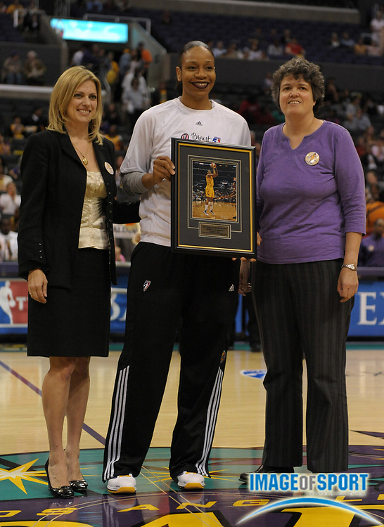 Aug 10, 2010; Los Angeles, CA, USA; Los Angeles Sparks forward Tina Thompson (center) is honored by co-owners Carla Christofferson (left) and Kathy Goodman (right) as the WNBA all-time leading scorer before the game against the Indiana Fever at the Staples Center. Photo by Image of Sport