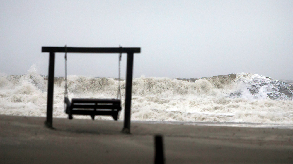 Waves on the southend beach of Tybee Island, Ga. pound the beach as Tropical Storm Irma heads into the state, Monday, Sept., 11, 2017. Tybee officials said wind gusts are reported at 60 miles per hour on the beach.  (AP Photo/Stephen B. Morton)
