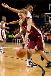 Florida St. guard Mara Freshour (10) dribbles past Virginia forward Lyndra Littles (1).  The Virginia Cavaliers women's basketball team hosted the Florida State Seminoles at the John Paul Jones Arena in Charlottesville, VA on February 10, 2008.