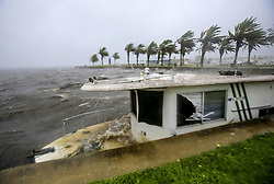 October 7, 2016 - Tallahassee, FL, USA - Hurricane Matthew winds washed up a boat as it bashes into the seawall at Lake Monroe in downtown Sanford on Friday, October 7, 2016. (Credit Image: © Jacob Langston/TNS via ZUMA Wire)