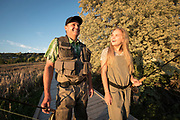 Father and daughter in waders walking together and smiling on footbridge while fly fishing Billingsley Creek Wildlife Management area in Hagerman, Idaho. MR