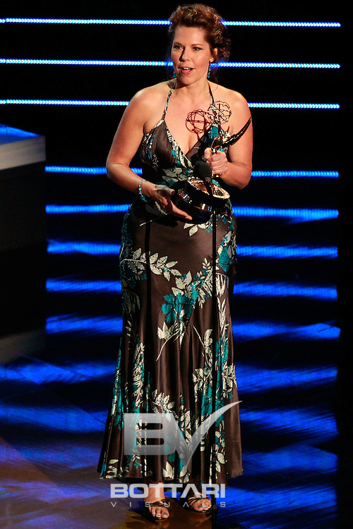 Director Cynthia J. Popp accepts the Outstanding Drama Series Directing Team award for 'The Bold and the Beautiful' onstage during the Daytime Emmy Awards on Sunday June 19, 2011 in Las Vegas. (AP Photo/Jeff Bottari)