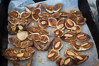 ACCIAROLI (POLLICA), ITALY - 5 OCTOBER 2016: Sun-dried figs stuffed with lemon zest, almonds and cinnamon prepared by 82-years old Fenisia La Greca are seen here in her kitchen in Acciaroli, a hamlet in the municipality of Pollica, Italy, on October 5th 2016. Fenisia La Greca grows fruit and vegetables in her own garden.<br /> <br /> To understand how people can live longer throughout the world, researchers at University of California, San Diego School of Medicine have teamed up with colleagues at University of Rome La Sapienza to study a group of 300 citizens, all over 100 years old, living in Acciaroli (Pollica), a remote Italian village nestled between the ocean and mountains in Cilento, southern Italy.<br /> <br /> About 1-in-60 of the area's inhabitants are older than 90, according to the researchers. Such a concentration rivals that of other so-called blue zones, like Sardinia and Okinawa, which have unusually large percentages of very old people. In the 2010 census, about 1-in-163 Americans were 90 or older.