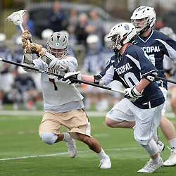 Staff photos by Tom Kelly IV<br /> Episcopal's  (20) runs with the ball as Haverford's Brandon Shima (7) tries to hack the ball from his stick during the Episcopal Academy at the Haverford School boys lacrosse game on Tuesday, April 7, 2015.