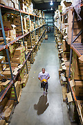 Cameron Bryant of Lorain in the ware house of sports equipment manufacturer Riddell in Elyria, Ohio on July 29, 2009.