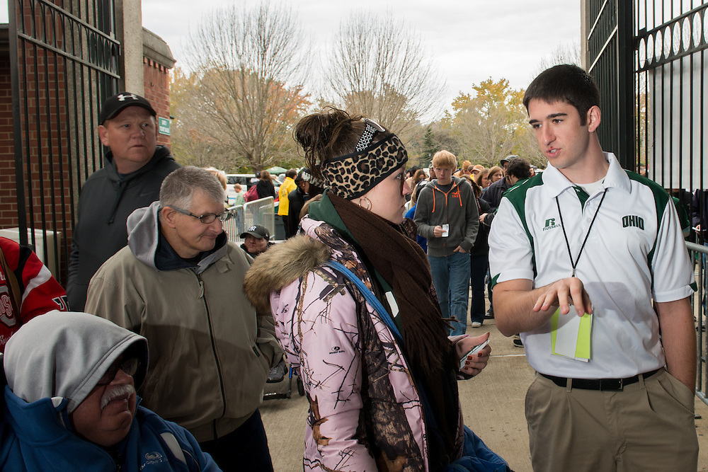 Gary Dillabaugh III helps a Bobcat fan in Peden Stadium before the Miami vs. OU football game. Photo by Elizabeth Held