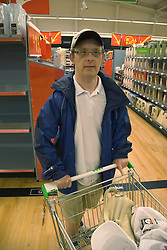 Day service user with learning disability out shopping at the supermarket,