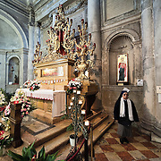 VENICE, ITALY - DECEMBER 13:  Pilgrims visit the relics of Santa Lucia (Saint Lucy) housed inside the church of Saint Geremia in Venice on December 13, 2010 in Venice, Italy. Saint Lucy's Day (Santa Lucia) celebrated on December 13th, is observed in Scandinavian countries but also in Northern Italy, Malta and some Mediterranean countries.