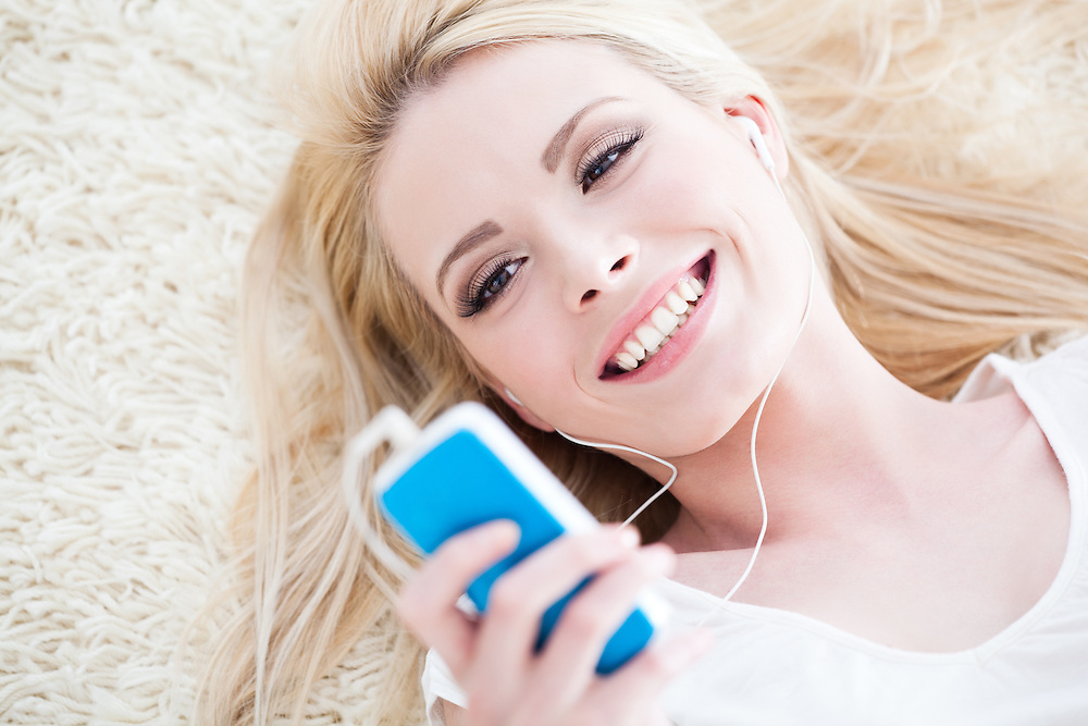 Beautiful young woman listening to music.