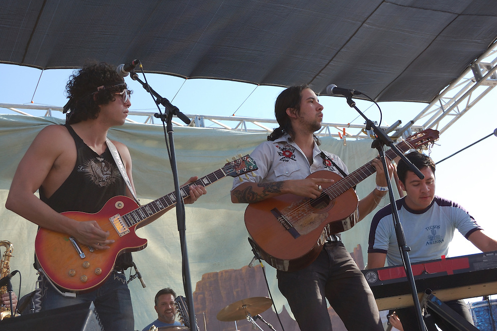 Guitarists and keyboardist playing during the Sergio Mendoza y la Orkestra concert at Tucson's first-ever Fiesta en el Barrio Viejo in 2010.