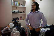 Shashi Kanth, a call center worker, dresses in his bedroom at home before leaving for work in Bangalore, India. (Shashi Kanth is featured in the book What I Eat: Around the World in 80 Diets.) MODEL RELEASED.
