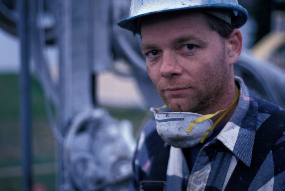 Canada, Ontario, (MR) Steve Fishwick at end of shift drilling rock outside Thunder Bay