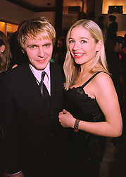 Pop star NICK RHODES and MISS MADELEINE FARLEY at a party in London on 24th February 1998.MFP 54