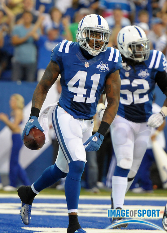 Sep 8, 2013; Indianapolis, IN, USA; Indianapolis Colts safety Antoine Bethea (41) celebrates after an interception with 25 seconds left against the Oakland Raiders at Lucas Oil Stadium. The Colts defeated the Raiders 21-17.