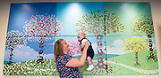 25 July 2017: Born Into A City of Culture - Hull and East Yorkshire Women and Childrens Hospital.<br /> During 2017, every baby born in Hull, East Yorkshire,  has been invited to have their footprint taken for a commissioned piece of artwork called 'Born Into A City of Culture'. Each month a new panel has been added to the foyer of Hull and East Yorkshire Women and Childrens Hospital. The artwork will be completed in January 2018.<br /> Over 2300 babies footprints have been taken so far. To mark the half-way point, a mother and baby born in each month from January to June, were invited back to look at the artwork. <br /> The tree trunks are hand-prints of midwives.<br /> The artwork has been produced by Hull design company Jenko.<br /> <br /> Pictured is Tina Dixon and 13 week old Freddie.<br /> <br /> <br /> Picture: Sean Spencer/Hull News &amp; Pictures Ltd<br /> 01482 210267/07976 433960<br /> www.hullnews.co.uk         sean@hullnews.co.uk