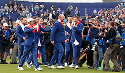 Team Europe captain Thomas Bjorn celebrates with the trophy after Europe win the Ryder Cup on day three of the Ryder Cup at Le Golf National, Saint-Quentin-en-Yvelines, Paris.