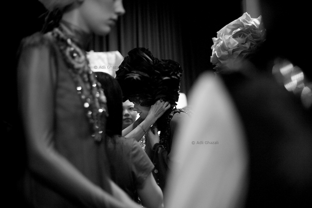 Model having her outfit done before the Islamic Fashion Festival held at JW Marriot Hotel on November 10, 2010 Kuala Lumpur, Malaysia.