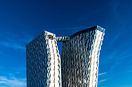 The Bella Sky Hotel, part of the Bella Center in Copenhagen, against a blue sky on a sunny day in Denmark.