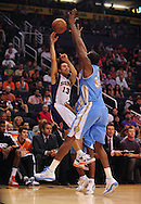 Oct. 22 2010; Phoenix, AZ, USA; Phoenix Suns point guard Steve Nash (13) makes a pass over Denver Nuggets' Melvin Ely (34) during the first half during a preseason game at the US Airways Center. Mandatory Credit: Jennifer Stewart-US PRESSWIRE.