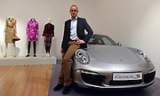© Licensed to London News Pictures. 15/11/2012. London, UK Mattias Kulla sits on the bonnet of a Porsche 991 which he and his design team created in 2011, the RCA has a long history of its students being employed by Porsche.  The Royal College of Art is celebrating its 175th anniversary with a major exhibition featuring more than 350 works of art and design by over 180 RCA graduates and staff, including Henry Moore, Barbara Hepworth, Tracey Emin, David Hockney, Peter Blake, Bridget Riley and Lucian Freud.  The RCA is the world's oldest art and design university in continuous operation. Its first students comprised a small group of teenage boys; today it educates some 1,200 postgraduate students from 55 different countries.. Photo credit : Stephen Simpson/LNP