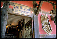 Zimmermann Saddlery sign hangs above original bldg at Ecomusee folk museum; Ungersheim, Alsace. France