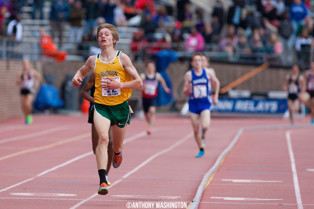 Andrew Hunter of Loudoun Valley High School crosses the finish line first to win the High School Boys 3000M Championship at the Penn Relays on Friday, April 25, 2014 in Philadelphia, PA.