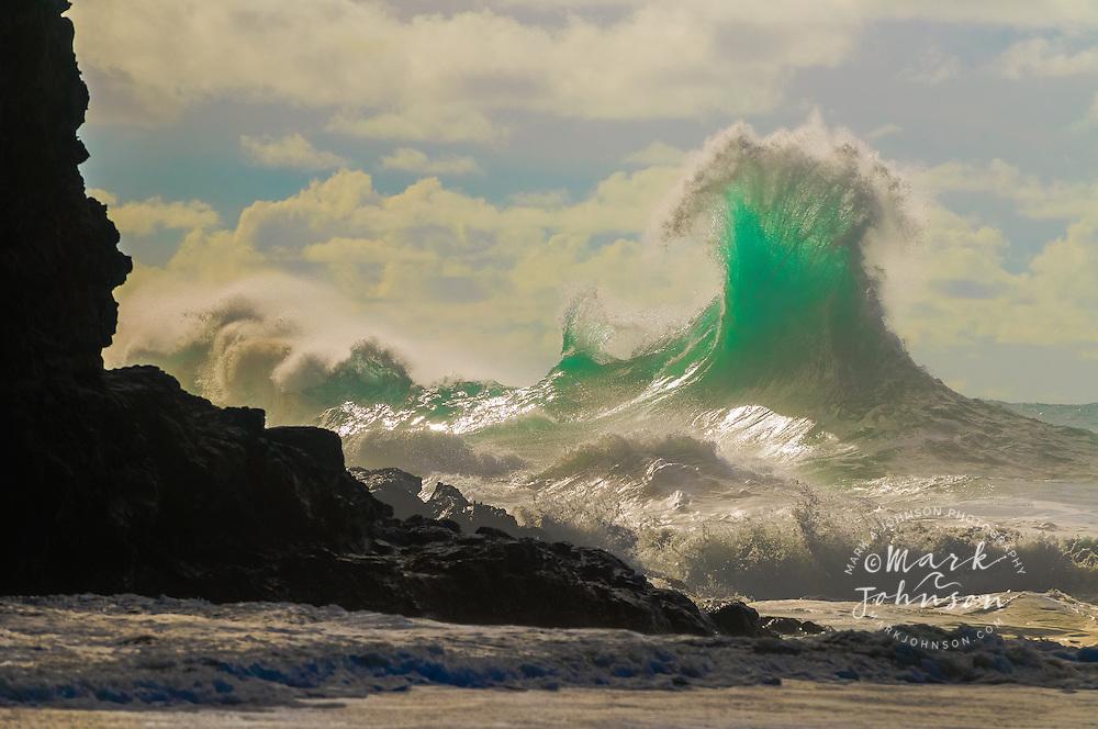 Large winter storm surf breaking off the Na Pali coast, Kauai, Hawaii