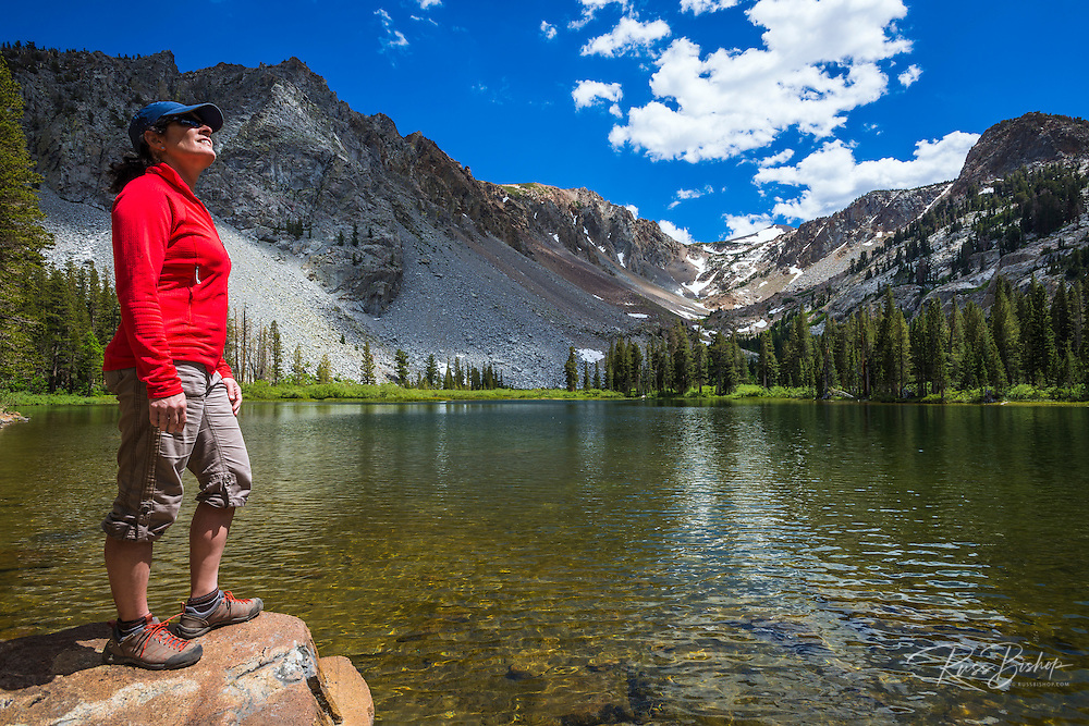 Hiker enjoying the view at Fern Lake, Ansel Adams Wilderness, June Lake, California
