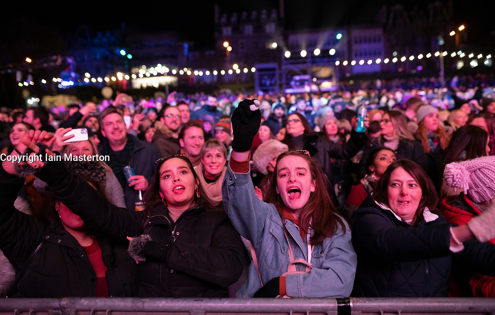 Edinburgh, Scotland, UK. 31st Dec 2019. Edinburgh's famous Hogmanay party. Pictured, excited audience at Rudimental gig at Hogmanay in the Gardens. Iain Masterton/Alamy Live News
