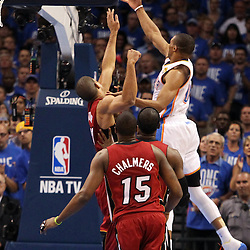 Jun 12, 2012; Oklahoma City, OK, USA;  Oklahoma City Thunder point guard Russell Westbrook (0) lays the ball up past Miami Heat small forward Shane Battier (31) during the first quarter of game one in the 2012 NBA Finals at the Chesapeake Energy Arena.  Mandatory Credit: Derick E. Hingle-US PRESSWIRE