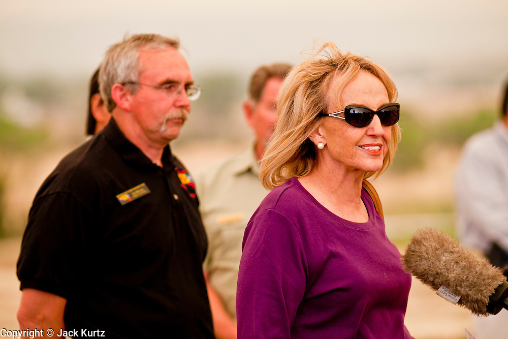 "04 JUNE 2011 - EAGAR, AZ: Gov Jan Brewer at a press conference at Round Valley Primary School, talks about the Wallow Fire Saturday. Smoke from the fire, more than 20 miles from Eagar, turned the sky bright orange. The fire grew to more than 140,000 acres early Saturday with zero containment. A ""Type I"" incident command team has taken command of the fire.   PHOTO BY JACK KURTZ"