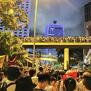A sea of protesters take over the streets and walkways during June protests in Hong Kong. Protesters are opposed to a controversial extradition bill.