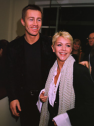 Footballer LEE CHAPMAN and his wife actress LESLEY ASH at a party in London on 27th November 1997.MDU 33