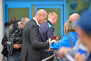 Reading manager, Jaap Stam arrives at the ground and signs programmes before kickoff during the EFL Sky Bet Championship match between Reading and Ipswich Town at the Madejski Stadium, Reading, England on 9 September 2016. Photo by Adam Rivers.