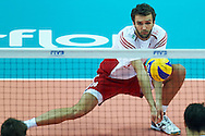 Poland's Mateusz Mika receives the ball while volleyball final match between Brazil and Poland during the 2014 FIVB Volleyball World Championships at Spodek Hall in Katowice on September 21, 2014.<br /> <br /> Poland, Katowice, September 21, 2014<br /> <br /> For editorial use only. Any commercial or promotional use requires permission.<br /> <br /> Mandatory credit:<br /> Photo by © Adam Nurkiewicz / Mediasport