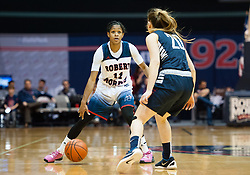 March 6 2016: Robert Morris Colonials guard Janee Brown (11) dribbles while being guarded by Fairleigh Dickinson Lady Knights guard Zeynep Akgun (20) during the first half in the NCAA Women's Basketball game between the Fairleigh Dickinson Lady Knights and the Robert Morris Colonials at the Charles L. Sewall Center in Moon Township, Pennsylvania (Photo by Justin Berl)