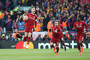 Liverpool midfielder Jordan Henderson (14) celebrates Liverpool forward Divock Origi goal 1-0 during the Champions League semi-final, leg 2 of 2 match between Liverpool and Barcelona at Anfield, Liverpool, England on 7 May 2019.