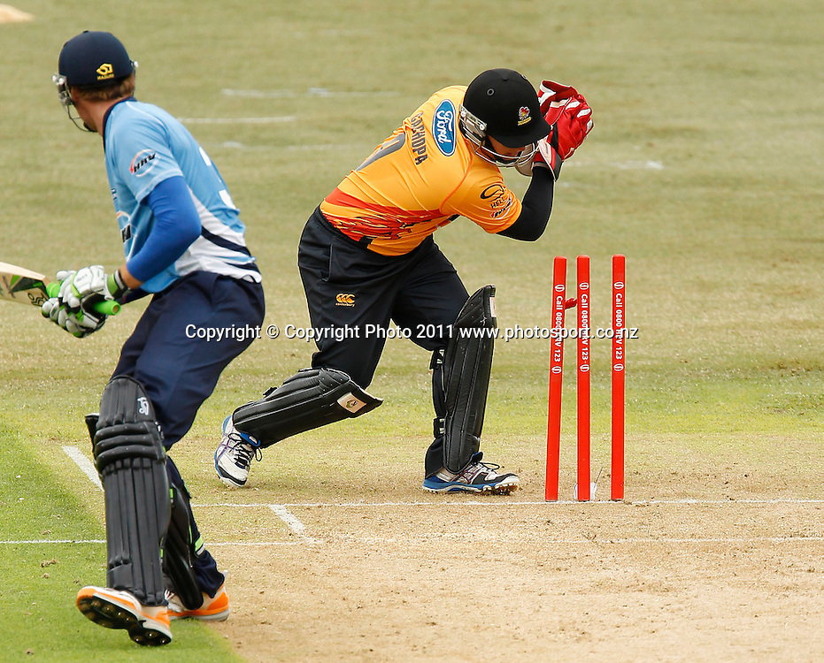 Martin Guptill of the Aces of the Aces is stumped by Craig Cachopa of the Firebirds during the HRV Cup Cricket Twenty-20,  Auckland Aces v Wellington Firebirds, Colin Maiden Park Auckland, Sunday 18 December 2011. Photo: Simon Watts/www.photosport.co.nz