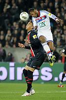FOOTBALL - FRENCH CUP 2011/2012 - 1/4 FINAL - PARIS SAINT GERMAIN v OLYMPIQUE LYONNAIS - 21/03/2012 - PHOTO JEAN MARIE HERVIO / REGAMEDIA / DPPI - MICHEL BASTOS (OL) / GUILLAUME HOARAU (PSG)