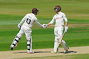 50 for Batty - Surrey's Gareth Batty is congratulated by Surrey's Ben Foakes after scoring his half century during the Specsavers County Champ Div 1 match between Hampshire County Cricket Club and Surrey County Cricket Club at the Ageas Bowl, Southampton, United Kingdom on 18 July 2016. Photo by Graham Hunt.