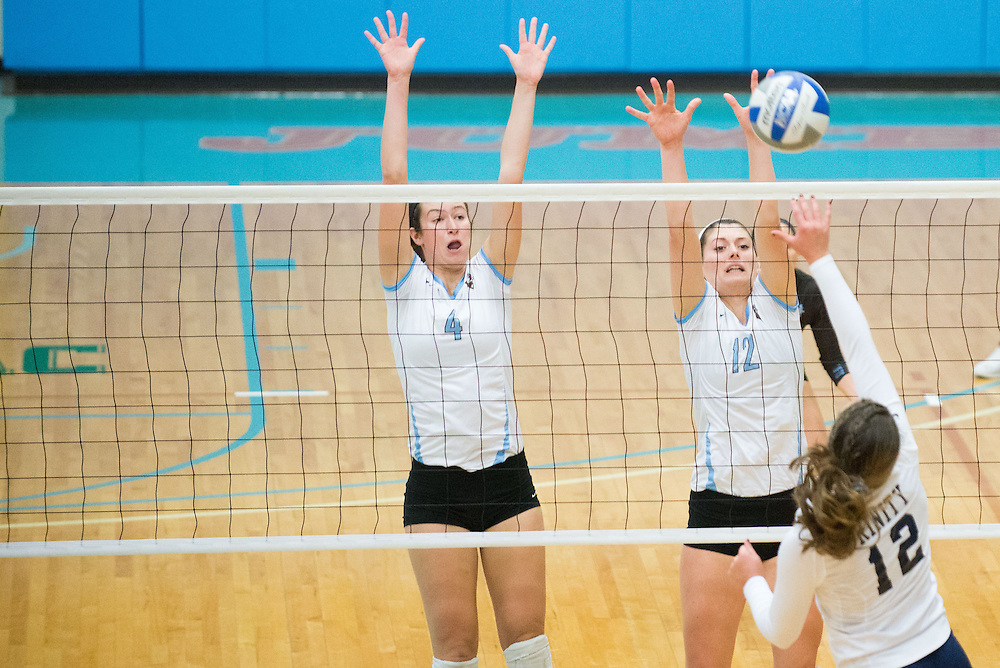 10/11/14 – Medford/Somerville, MA – Tufts MH/OPP Elizabeth Ahrens, A17, and Tufts OH/OPP Maddie Kuppe, A17, go up for a block during the Tufts volleyball 3-0 victory against Trinity in Cousens Gym on October 11th, 2014. (Nicholas Pfosi / The Tufts Daily)