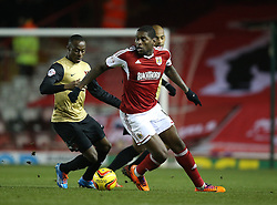 Bristol City's Jay Emmanuel-Thomas and Leyton Orient's Moses Odubajo in action - Photo mandatory by-line: Matt Bunn/JMP - Tel: Mobile: 07966 386802 26/11/2013 - SPORT - Football - Bristol - Ashton Gate - Bristol City v Leyton Orient - Sky Bet League One