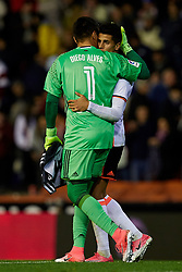 April 6, 2017 - Valencia, Valencia, Spain - Diego Alves (L) goalkeeper of Valencia CF embraces teammate Joao Cancelo during the La Liga match between Valencia CF and Real Club Celta de Vigo at Mestalla Stadium on April 6, 2017 in Valencia, Spain. (Credit Image: © David Aliaga/NurPhoto via ZUMA Press)