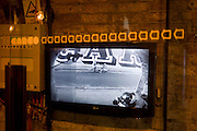 Photographer takes picture in entrance of Shoreditch restaurant and appears on CCTV screen.