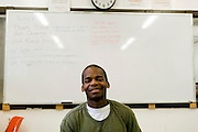 "Woodbourne Correctional Facility inmate and Bard College student John Dickerson in the computer room..Story: The Bard Prison Initiative.Former inmate Carlos Rosario, 35-year-old husband and father of four, was released from Woodbourne Correctional Facility after serving more than 12 years for armed robbery. Rosado is one of the students participating in the Bard Prison Initiative, a privately-funded program that offers inmates at five New York State prisons the opportunity to work toward a college degree from Bard College. The program, which is the brainchild of alumnus Max Kenner, is competitive, accepting only 15 new students at each facility every other year. .Carlos Rosario received the Bachelor of Arts degree in social studies from the prestigious College Saturday, just a few days after his release. He had been working on it for the last six years. His senior thesis was titled ""The Diet of Punishment: Prison Food and Penal Practice in the Post-Rehabilitative Era,"".Rosado is credited with developing a garden in one of the few green spaces inside the otherwise cement-heavy prison. In the two years since the garden's foundation, it has provided some of the only access the prison's 800 inmates have to fresh vegetables and fruit...Rosario now works for a recycling company in Poughkeepsie, N.Y...Photo © Stefan Falke"
