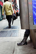 USA, NY, New york city, Manhattan, woman on public phone in the street with only her boots in view