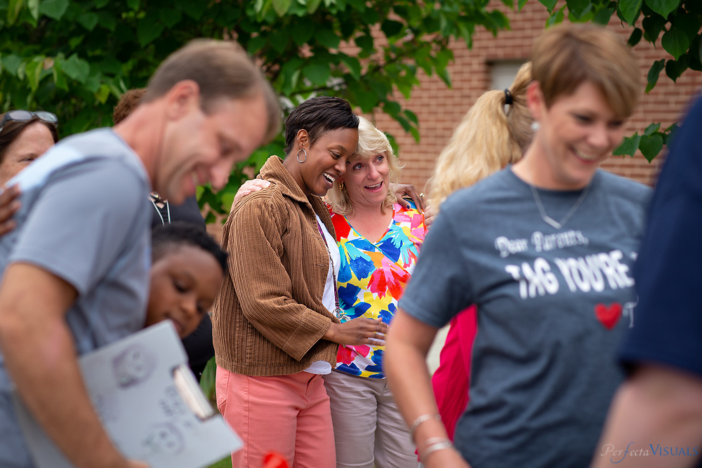 Last day of school at Ronald E. McNair Elementary School.<br /> <br /> Kimberley Cathey consoles a tearful Pam Huffman, right.<br /> <br /> <br /> Photographed, Tuesday, June 12, 2018, in Greensboro, N.C. JERRY WOLFORD and SCOTT MUTHERSBAUGH / Perfecta Visuals